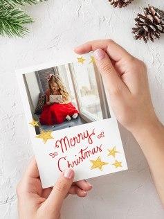 Valmis Ifolorin joulukortti tähti- ja tekstikuvituksella.