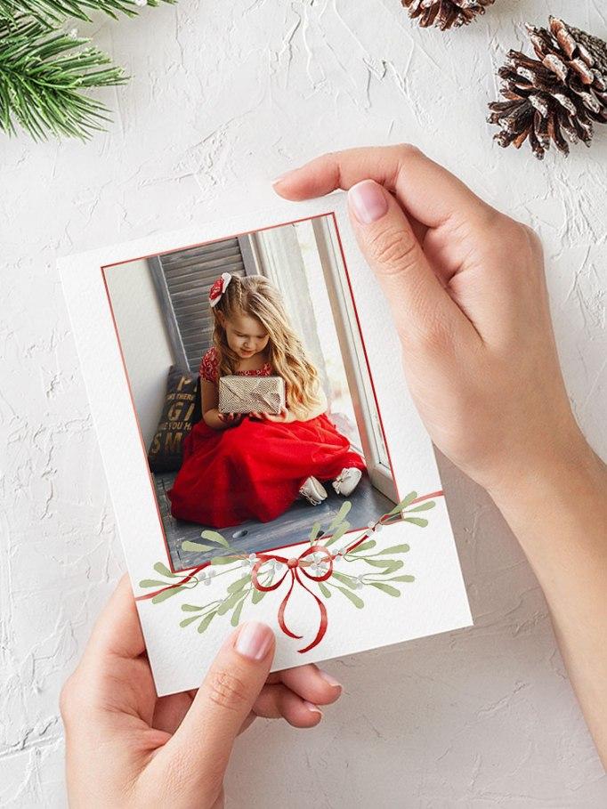 Valmis Ifolorin joulukortti misteli- ja rusettikuvituksella.